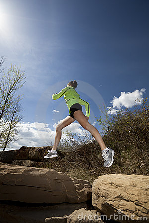 Athletic Woman Jumping While Jogging