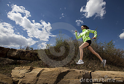 Athletic Woman Jumping While Running