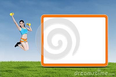 Athletic woman jumps next to empty board