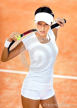 Athletic woman keeps tennis racket