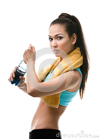 Athletic woman opens bottle of water