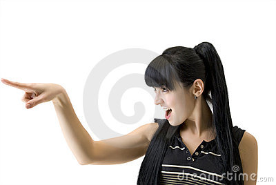 Athletic woman pointing a finger in the direction