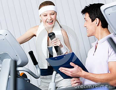 Athletic woman training on gym