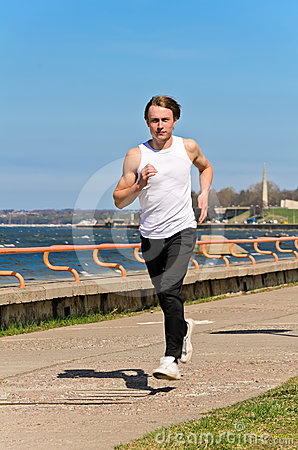 Athletic young male running