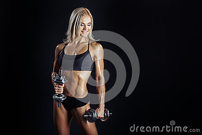 Athletic young woman doing a fitness workout with dumbbels