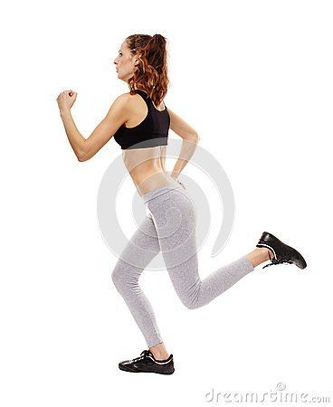 Athletic young woman doing jogging