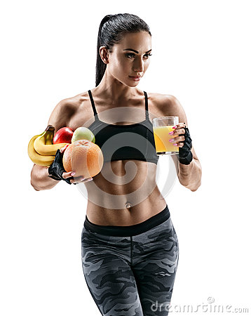 Free Athletic Young Woman In Sports Wear Hold Fresh Fruits And Glass Orange Juice. Royalty Free Stock Photography - 90570237