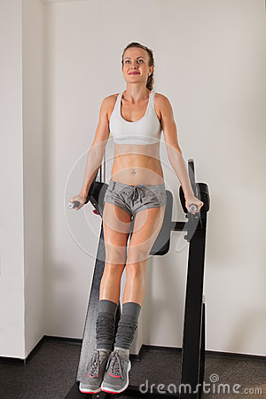 Free Athletic Young Woman Training Press On Exerciser Royalty Free Stock Image - 27478926