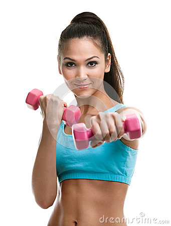 Athletic young woman works out with dumbbells