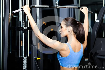 Athletic Young Woman Works Out On Simulator Royalty Free Stock Image - Image: 28494546