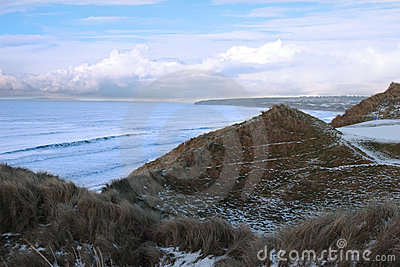 Atlantic ocean beside a snowy golf course