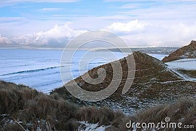 Atlantic ocean beside a snowy golf course
