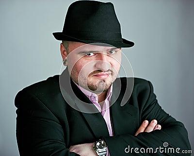 Atrractive man in black hat