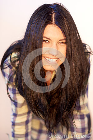 Atrractive smiling girl with brown hairs.