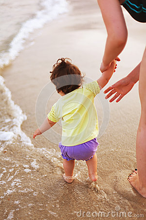 Attending baby on sea shore