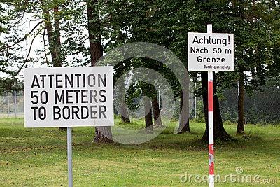 Attention sign posted at Checkpoint Alpha in East Germany