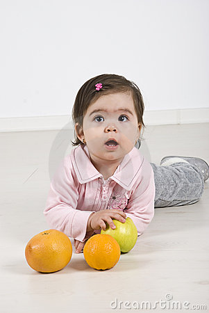 Free Attentive  Baby With Fruits Royalty Free Stock Photo - 14064625