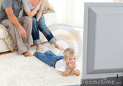 Attentive little boy watching television