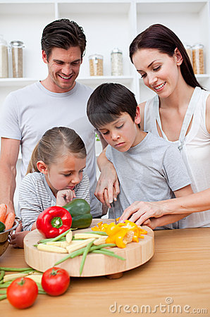 Attentive parents cooking with their children