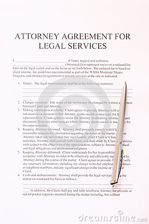Attorney agreement for legal services form and pen. top view