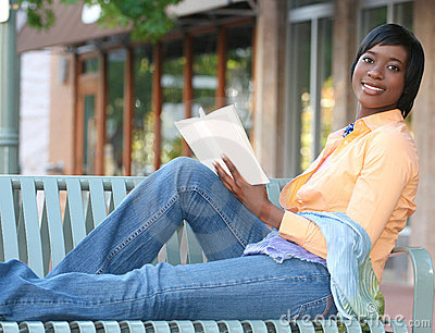 Attractive African-American Female Reading a Book