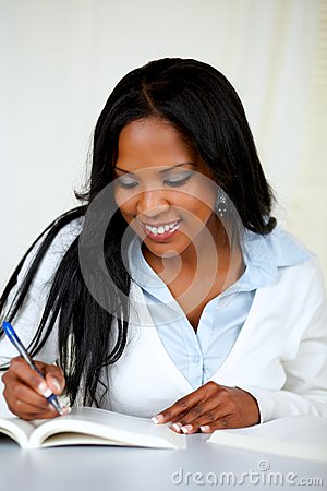 Attractive african woman studying