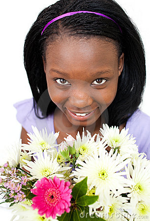 Attractive Afro-american woman holding flowers