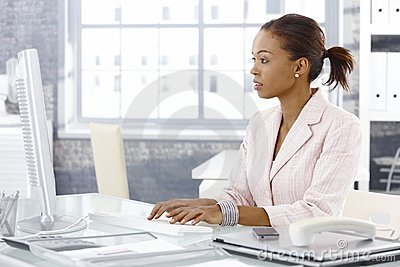 Attractive afro businesswoman at work