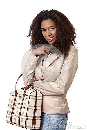 Attractive afro woman with handbag smiling