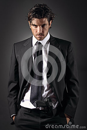 Free Attractive And Elegant Man Posing With A Gun In His Trousers Stock Image - 31249471