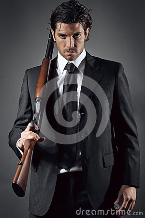 Free Attractive And Elegant Man Posing With Shotgun Stock Images - 31246554