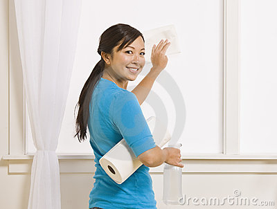 Attractive Asian Female Cleaning Window