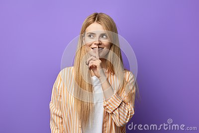 Attractive awesome happy woman with finger on her lips Stock Photo