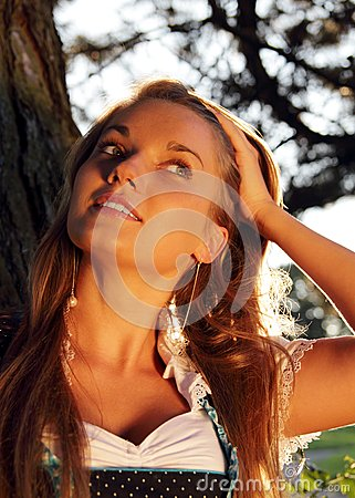 Attractive Bavarian Girl with hand in hair