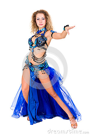 Attractive belly dancer dressed in a blue costume