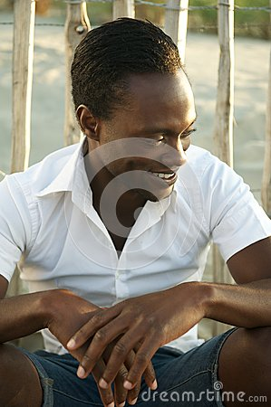 Attractive black man smiling outdoors