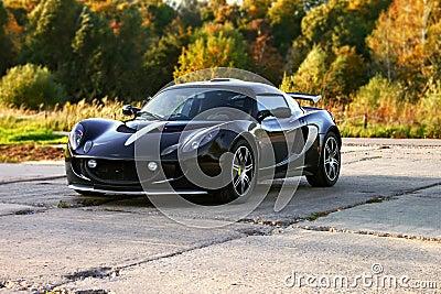 Attractive black sport car with big wheels.