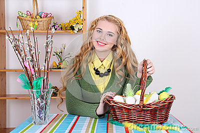 Attractive blond, basket with easter eggs and pussy-willow
