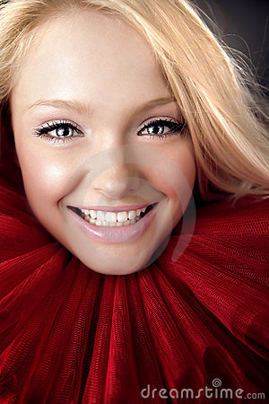 Attractive blond beauty in red theatrical jabot