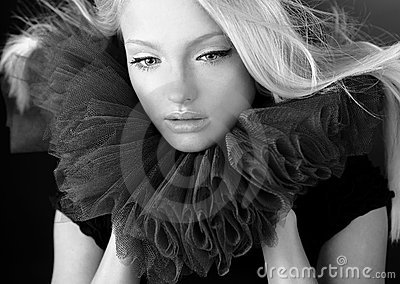 Attractive blond beauty in a theatrical jabot.