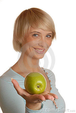 Attractive blond girl with an apple