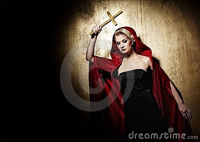 Attractive blond lady with a golden cross.