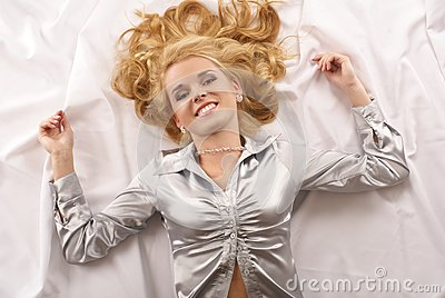 Attractive blond lying on a white blanket
