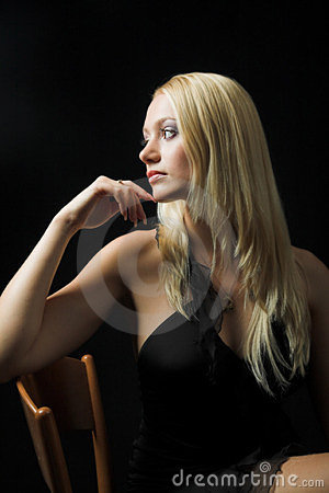 Attractive blond model on black background