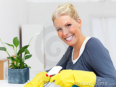 Attractive blond woman cleaning your house