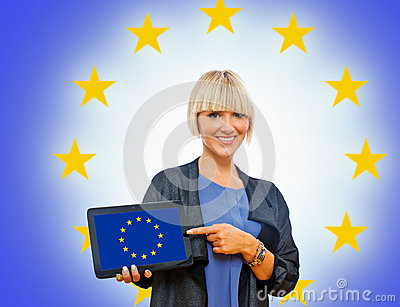 Attractive blond woman holding tablet with europe flag