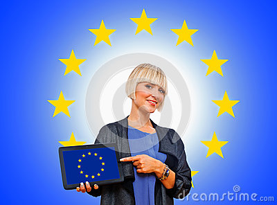 Attractive blond woman holding tablet with european flag