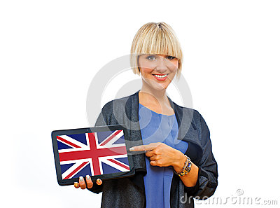 Attractive blond woman holding tablet with united kingdom flag