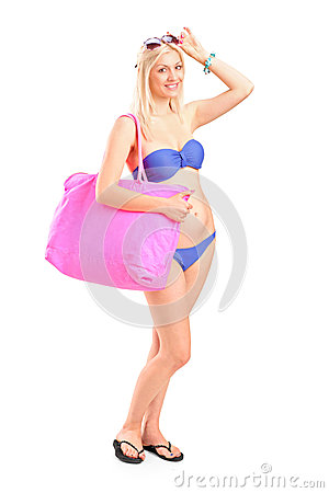 Attractive blond woman in swimsuit posing