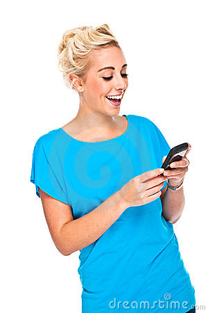 Free Attractive Blond Woman Texting On Cell Phone Stock Images - 16745524